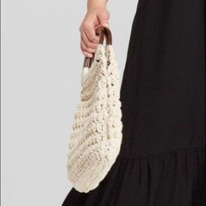 Woman's knit hand bag